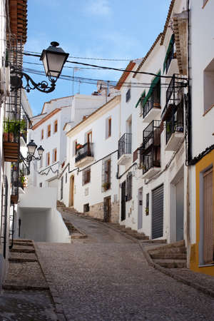 altea: Street going uphill at the old town of Altea, Spain Stock Photo