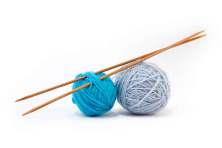 yarn: Blue yarn balls with bamboo knitting needles