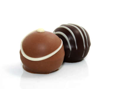 confiserie: two chocolate truffles on white background