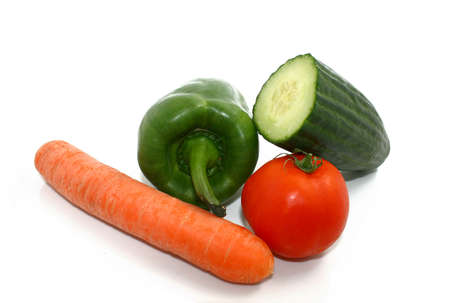 carot: some vegetables, a carot, a paprika, a tomato, and a cucumber Stock Photo
