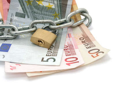 money locked by chain and padlock photo