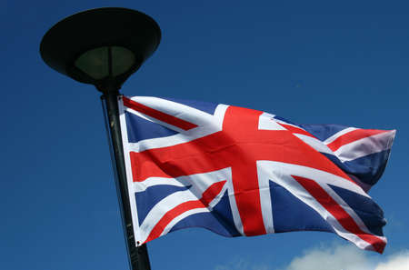 flagpoles: british flag in front of blue sky