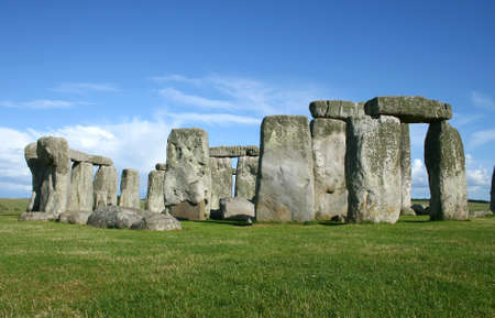 stonehenge with blue sky and green grass photo