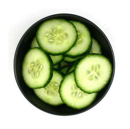 cucumber slices in a black bowl Stock Photo - 4402397