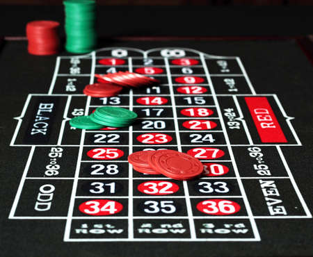gambling table with red and green jetons.