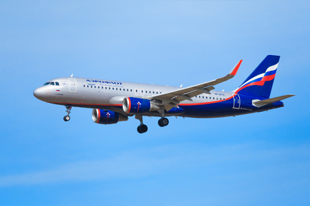 Moscow region, Russia, april 2018: Close up view of a airplane of the Russian Airlines Aeroflot flies in azure sky (editorial) Editorial