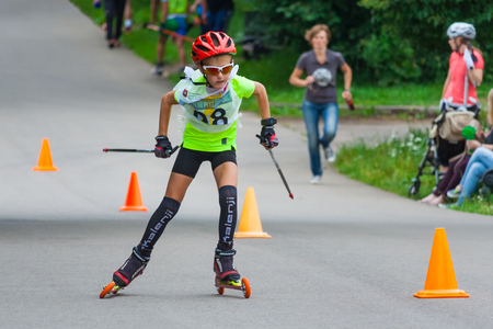 Young Roller skater is on the road in race a background of spectators in blur at the