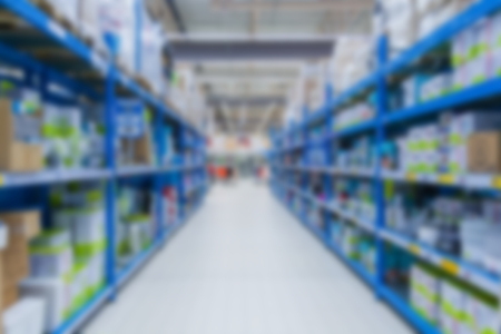 Perspective view on a warehouse with consumer products in blur (background) Stock Photo