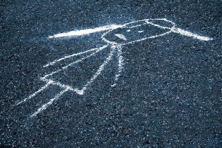 Sad child painted chalk on the asphalt with copy space (concept) Imagens