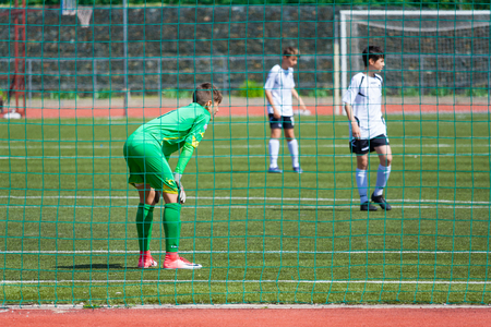 Moscow, Russia, june 2018: young football players match, goalkeeper stands at the gate (editorial) Editorial