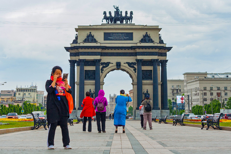 Moscow, Russia, june 2018: triumphal arch on Poklonnaya Hill surrounded by tourists from Asia (editorial)