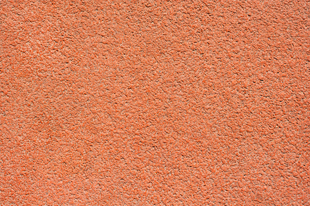 Orange tartan surface of a running track as texture, background