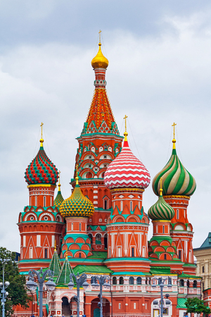 Saint Basils Cathedral (Pokrovsky Cathedral) on Red Square in Moscow (Russia) against a gray cloudy sky 写真素材