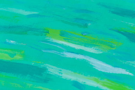 Turquoise wooden board with green paint stains as background, texture (abstract)