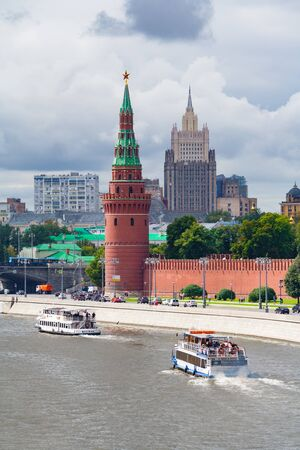 Moscow, Russia, August, 2018: View of the Kremlin Embankment with a two pleasure ships sailing along the river (editorial)
