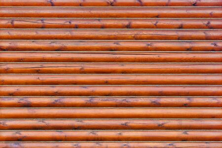 Brown wooden wall from horizontal logs as texture, background Stock Photo