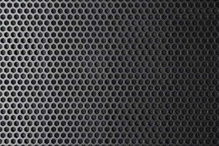 Black metal surface with regular round holes  texture 版權商用圖片