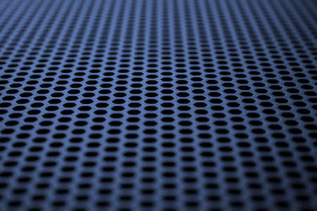 Deep blue metal surface with regular round holes