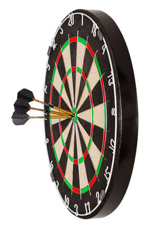 Side view on professional sisal dartboard with three gilded darts in center isolate on  white
