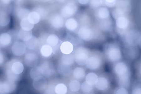 Blue bokeh glitter in blur as background (defocused)