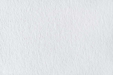 Grainy white paper surface as texture, background (close up, macro)