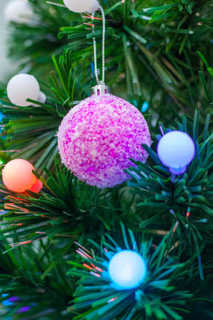 Close up view on a Christmas tree decorated by multicolored balls