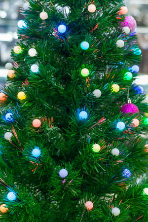 View on a multicolored garlands on a Christmas tree