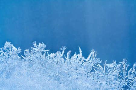 Frosty pattern on the blue window glass with copy space 版權商用圖片