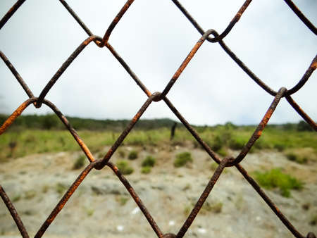 Old iron wire fence, close-up wire mesh fence