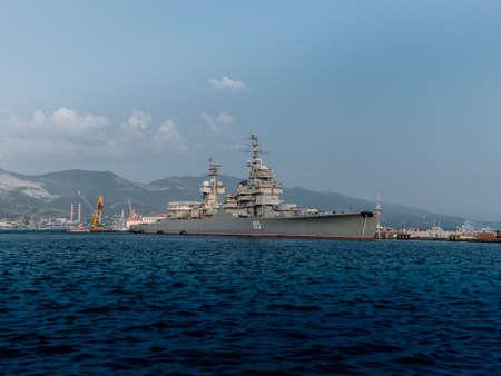 battleship: Grey modern warship sailing in still water against sky