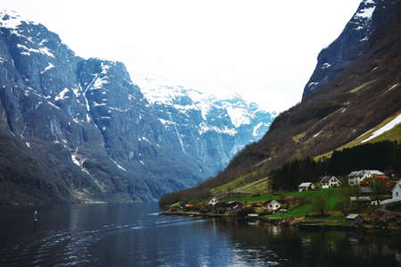 Flam, Norway, Europe. Beautiful Norwegian countryside with reflection of the mountains on the river