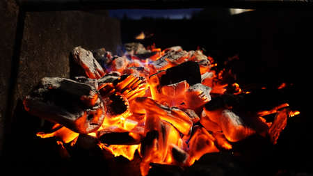 Embers fire fireplace grill fire flame, black background - bright photo