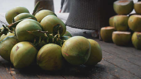 Sweet green coconuts. Coconut tropical fruit for drink in China