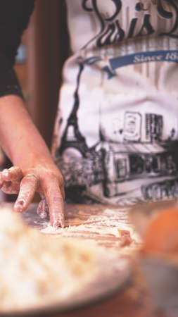 Close up scene of female hands making dough. Soft focus, kitchen, cooking ingredients Stockfoto