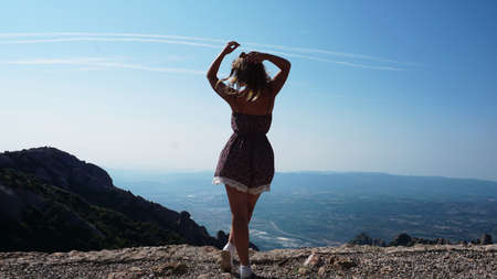 Young happy woman enjoying the magnifisent view of Montserrat Mountains