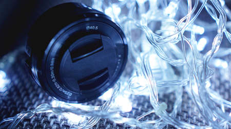 Photo lens with lens reflections close up shot with blue lights