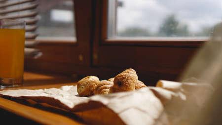 French breakfast with croissant, kraft crockery on kraft paper. Mini croissants Stock Photo