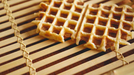 Sweet fresh Viennese waffles on rustic wooden background. Selective focus, horizontal. Stock Photo