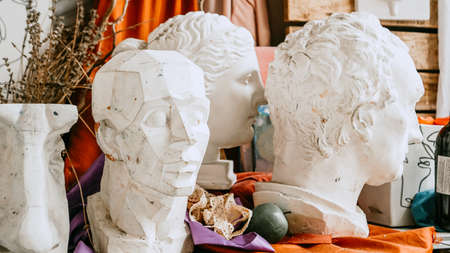 Sculpture bust and tools in an art workshop background