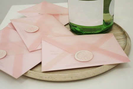 Gift certificates in a pink envelope. Wedding invitation or Valentines Day cards