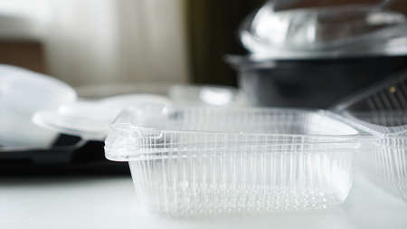 Black and white Plastic food containers on blurred background