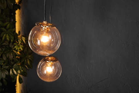 Decorative light tungsten bulbs against black wall background