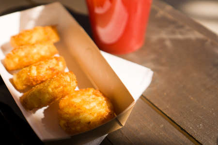 Potato pancakes on stone - hash browns street food on wooden background