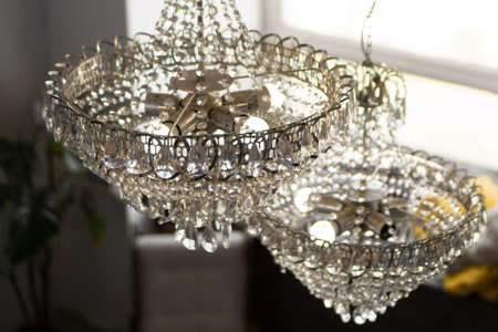 Beautiful crystal chandeliers in a light room