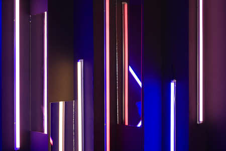 Background of an empty room with brick walls and neon lights, laser lines