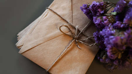 Envelopes with dry lavender. Stack of vintage letters tied with twine