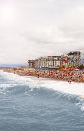 BATUMI, GEORGIA - August 18,2019. People relax on beach. Popular Batumi beach