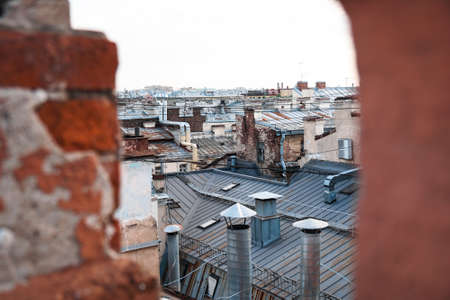 Cityscape view over the rooftops of St. Petersburg. View of the rooftops against the sky Фото со стока