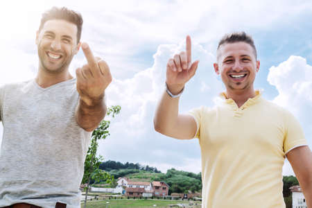 cool boy: relaxed men making jokes and greetings