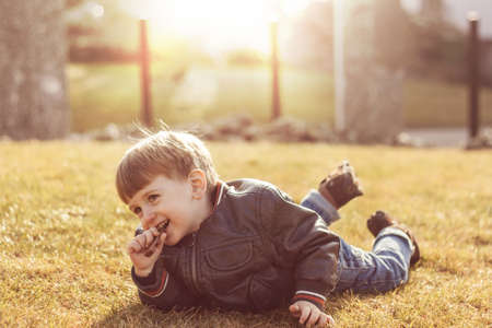 lieing: Smiling child lieing on the grass